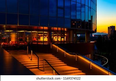 Close up of modern skyscraper illuminated at night