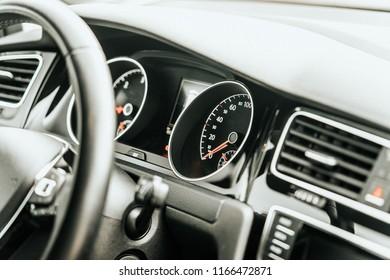 Close up modern vehicle dashboard interior speedometer