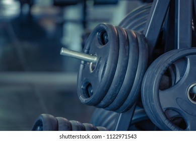 Close up of modern Weights for a bar in the gym, bodybuilding and gym equipment concept.