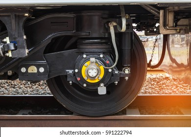 Close up modern wheel train system on track
