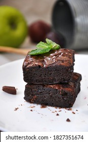 Close up moist and chewy fudge brownie on white plate with copy space