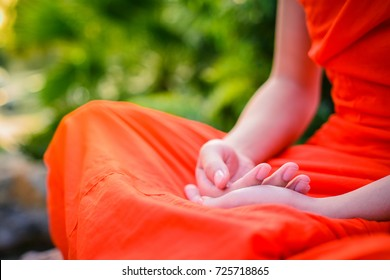 Close up Monk in Buddhism Meditation in nature with sunlight Thailand.Select focus