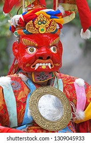 Close up of monk performing Cham dance with holy mask in Leh India