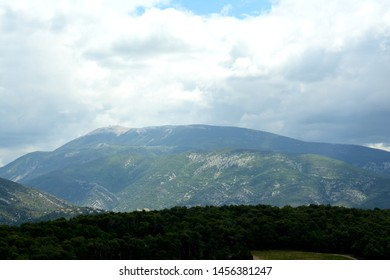 Close up of the Mont Ventoux, Ventoux mountain. In the foreground  mountains, fields, forest. A cloudy sky. Spring in France, Provence, Vaucluse.