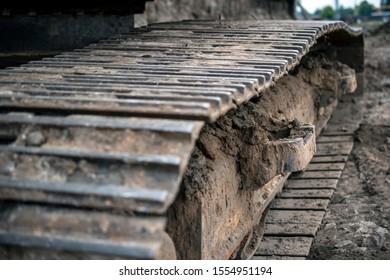 close up of moody excavator caterpillar track