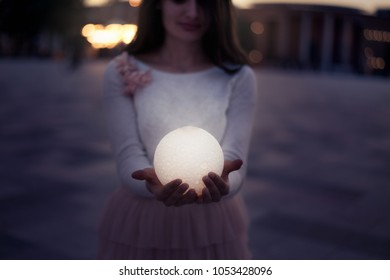 Close up moon in woman's hands