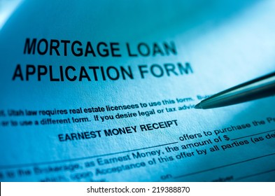 Close up of mortgage application form and male hand with a pen.