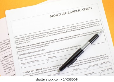 Close up of a mortgage application and a pen