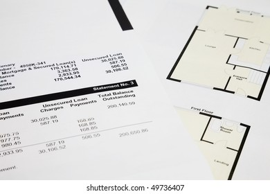 close up of a Mortgage statement and House Floor plan