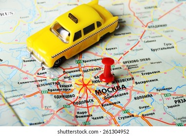Close up of  Moscow  , Russia  map and taxi toy