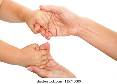 Close up of mother and babies hands together.Isolated on white.