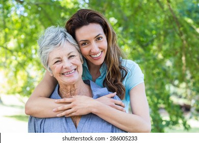 Close up of mother and grandmother smilling in a park on a sunny day