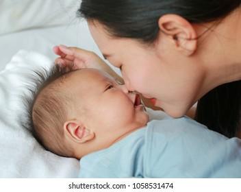 Close up mother nice-smelling newborn baby boy.