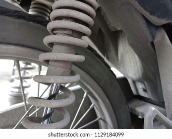 Close Up of Motorcycle Superbike Shock Absorber and Spring