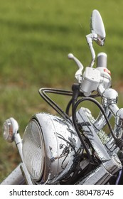 The close up of motorcycle wheel with headlight