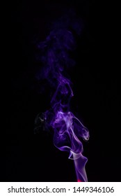 Close up movement of colorful smoke isolated on black background.Abstract background smoke curves and wave on black background.