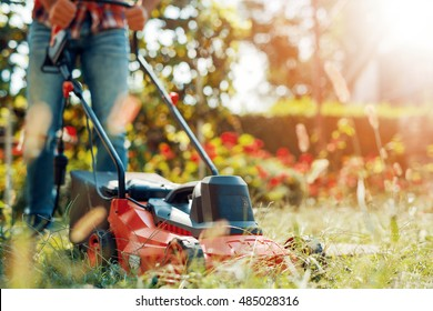 Close up of mower cutting the grass.