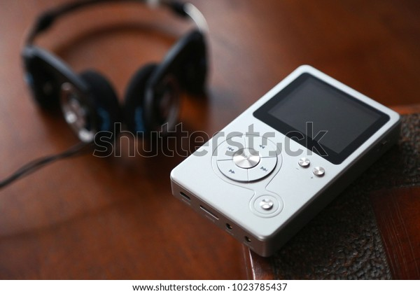 Close of mp3 player with earphones