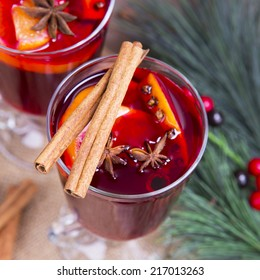 Close up of mulled wine glass with cinnamon stick