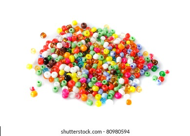close up multi colored beads heap isolated on white
