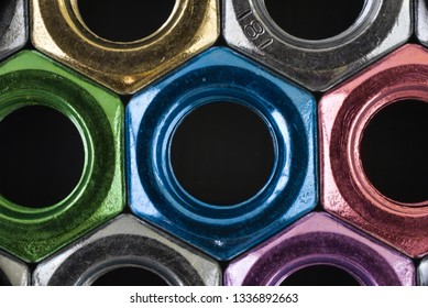 Close up multicolor hex nuts put row abstract style. Macro photo.