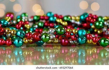 Close up of multicolored Christmas garland with reflections
