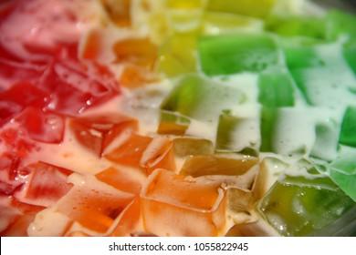 A close up of multi-colored Jello