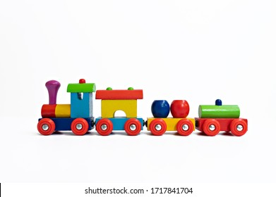 A close up of a multi-colored train toy on white background