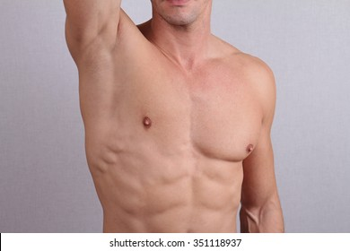 c1cf76035 Close up of muscular male torso, chest and armpit hair removal. Male Waxing