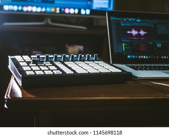 close up music machine with pads on the table sound work place with laptop and external monitor