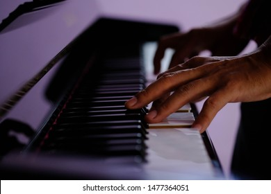 Close up of a music performer's hand playing the piano,Playing Piano Close-up Shot,Low key image
