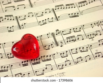Close up of a music score and a red heart