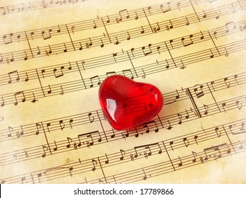 Close up of a music score with red heart