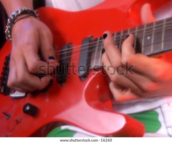 Close up musician playing electric guitar