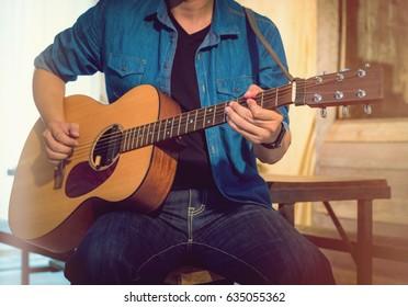 Close up musician playing guitar.