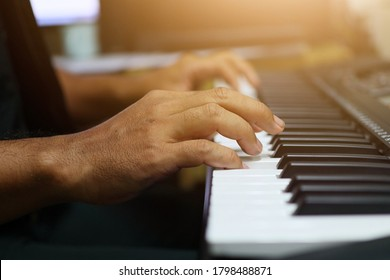 A close up of a musician playing the piano With vintage filters Music learning concept