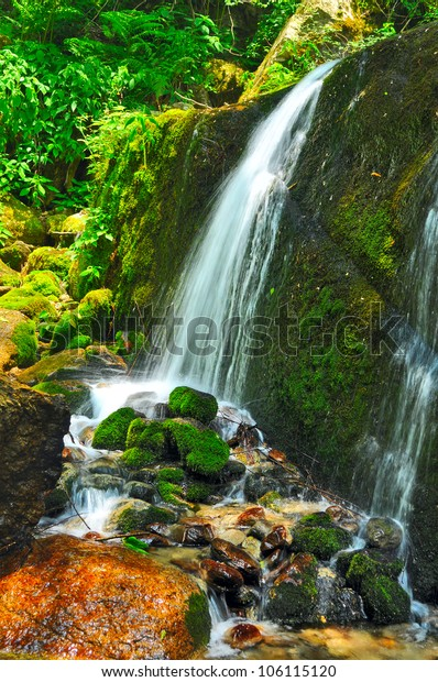 close up of narrow stream of waterfall