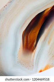 Close up of natural agate crystal surface, Agate crystal cross section. Abstract background texture.