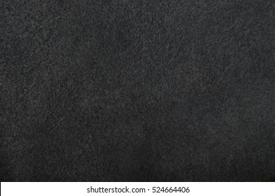 Close up of natural black suede leather background