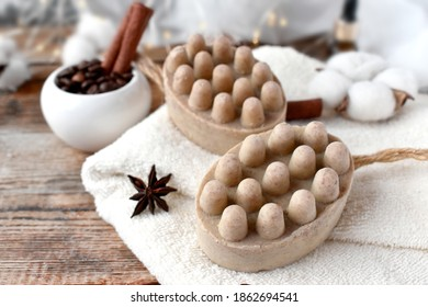 Close up natural soap bars, coffee beans, spicies  and towel  on wooden background. Body care, wellness and relax concept. Spa aromatherapy composition for hygge style.