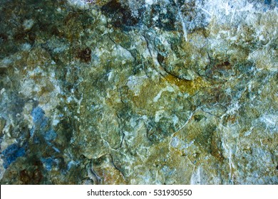 Close up of natural stone, grey marble with golden veins. High resolution photo