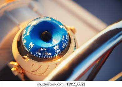 Close up of nautical compass on yacht