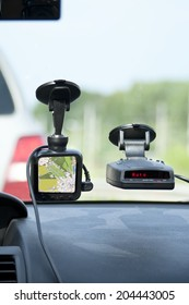 Close up of the navigator and radar detector on a car windscreen, concept of modern way of driving