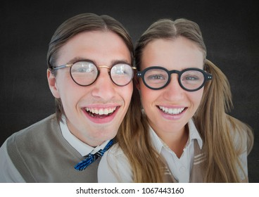 Close up of nerd couple against grey wall