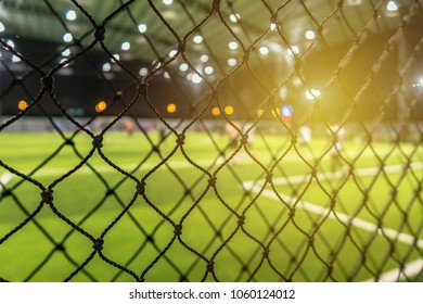 Close up net of artificial grass indoor football field for protect the ball over football field. Selective focus.