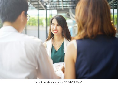 close up new graduated asian woman talking or answer question from businesspeople for job interview at modern loft office company, we're hiring concept