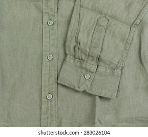 Close up new green linen shirt isolated on white background