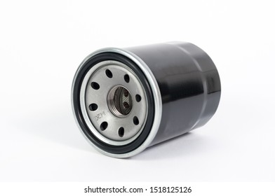 Close up new oil filter engine car isolated on white background studio, copy space