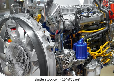 Close up new truck diesel engine motor with different parts and details. Truck engine motor filter, alternator, electronic device, electric parts, fan. Abstract modern automotive industrial background
