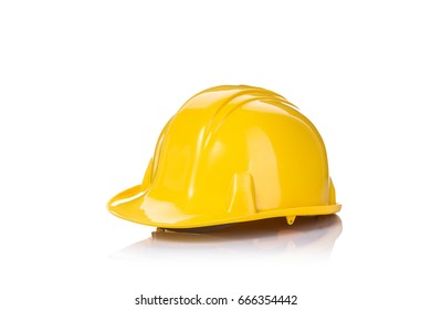 Close up new yellow construction safety helmet. Studio shot isolated on white background